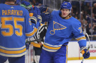 St. Louis Blues' Klim Kostin (37) is sprayed with water as he celebrates his first career NHL goal during an NHL hockey game against the Nashville Predators the first period Saturday, Nov. 23, 2019, in St. Louis. (AP Photo/Dilip Vishwanat)