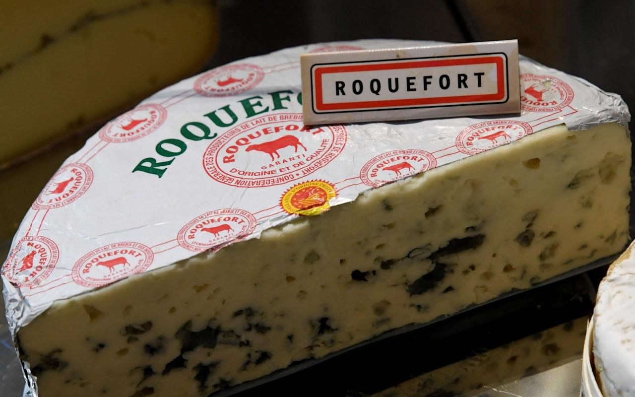 Macron backs plans to tell French to eat less cheese to help the environment