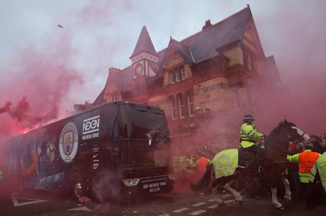 <p>Soccer Football – Champions League Quarter Final First Leg – Liverpool vs Manchester City – Anfield, Liverpool, Britain – April 4, 2018 Liverpool fans set off flares and throw missiles at the Manchester City team bus outside the stadium before the match Action Images via Reuters/Carl Recine </p>
