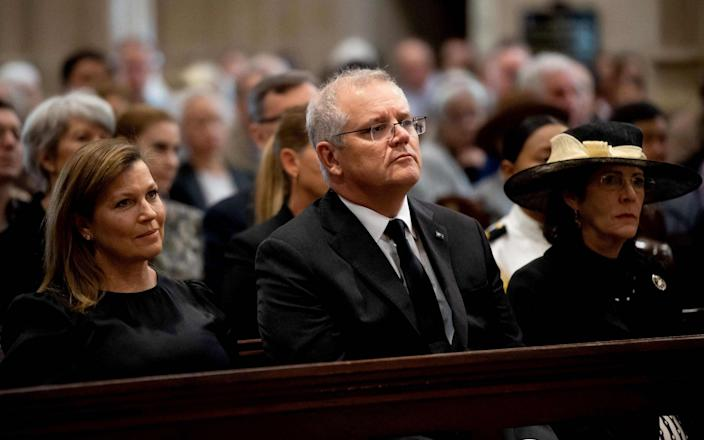 Australia's Prime Minister Scott Morrison (C) and his wife Jenny Morrison (L) attend a special prayer service to commemorate the death of Prince Philip, Duke of Edinburgh, at St Andrew's Cathedral in Sydney - BIANCA DE MARCHI