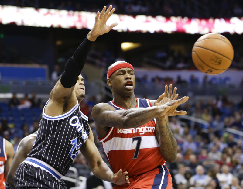 Washington Wizards' Al Harrington (7) passes the ball as he is defend by Orlando Magic's Tobias Harris (12) during the first half of an NBA basketball game in Orlando, Fla., Friday, March 14, 2014. (AP Photo/John Raoux)