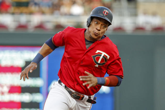 Minnesota Twins' Jorge Polanco rounds third base en route to scoring against the Chicago White Sox on a single by Nelson Cruz in the first inning of a baseball game Monday, Aug 19, 2019, in Minneapolis. (AP Photo/Bruce Kluckhohn)