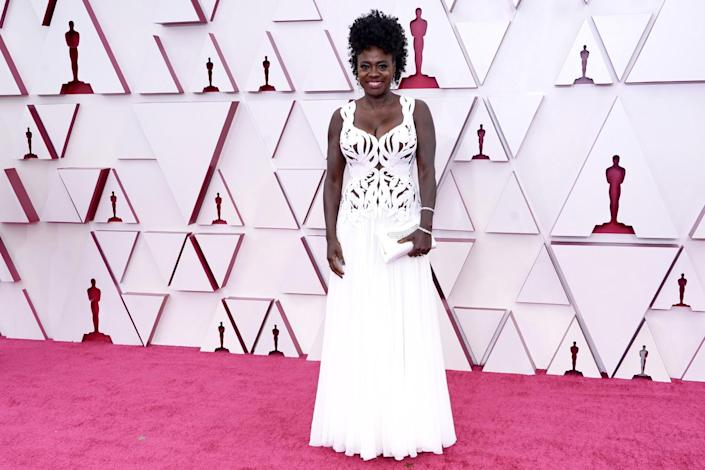 Viola Davis in a white, lacy long dress from Alexander McQueen.
