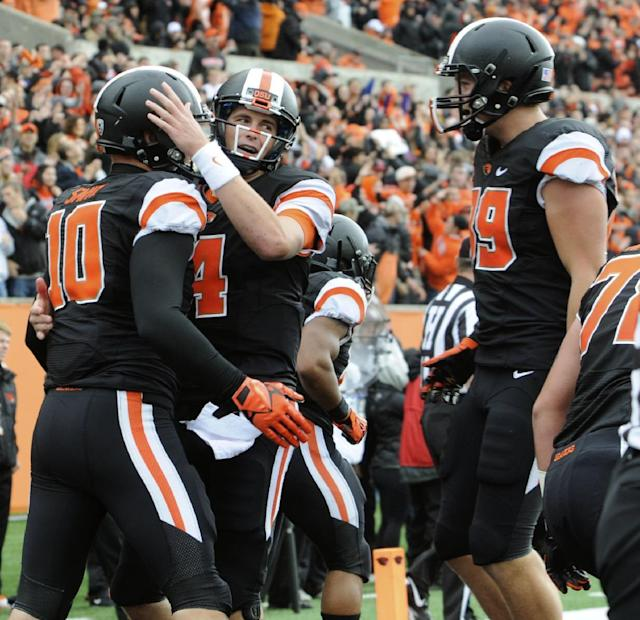 Oregon State's quarterback Sean Mannion (4) congratulates Caleb Smith (10) on his touchdown reception against Colorado in the first half of an NCAA college football game on Saturday, Sept 28, 2013, in Corvallis, Ore. (AP Photo/Greg Wahl-Stephens)
