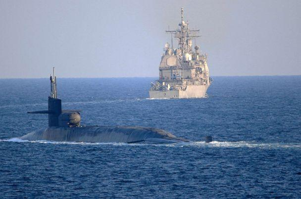 PHOTO: In this photo made available by the U.S. Navy, the guided-missile submarine USS Georgia, front, with the guided-missile cruiser USS Port Royal, transit the Strait of Hormuz in Persian Gulf, Monday, Dec. 21, 2020. (Mass Communication Specialist 2nd Class Indra Beaufort/U.S. Navy via AP)