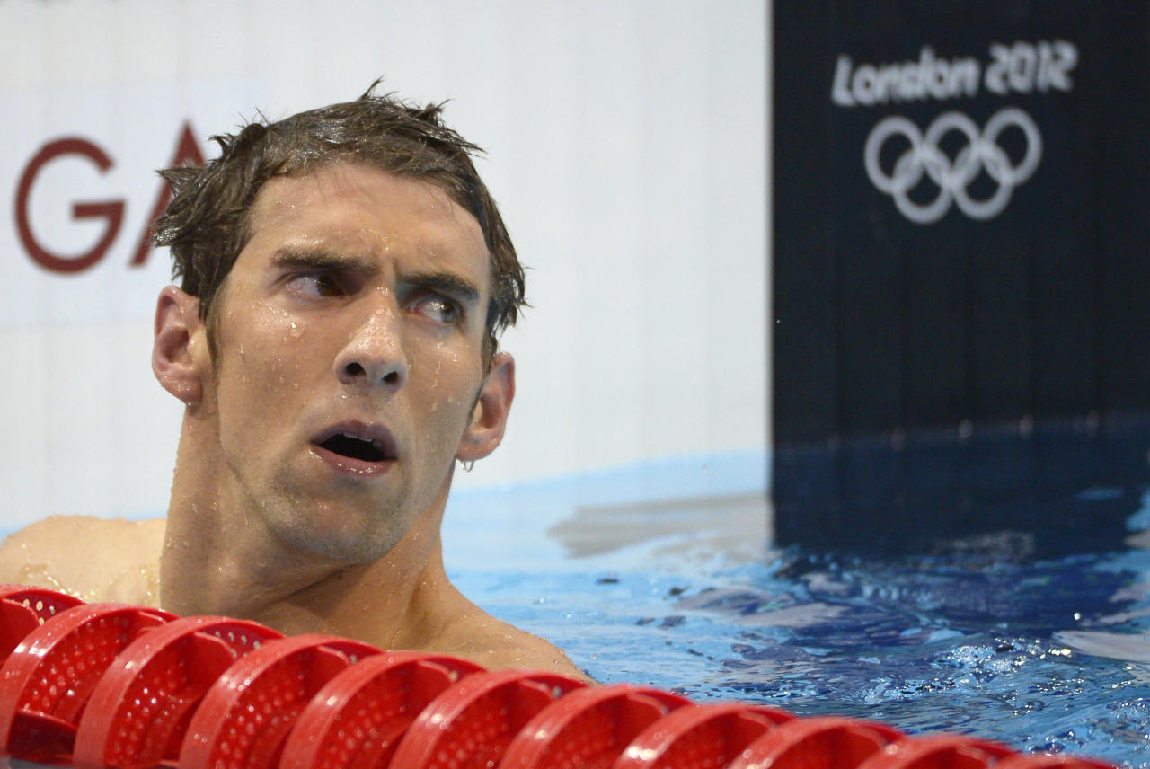 United States' Michael Phelps reacts after placing fourth in the men's 400-meter individual medley swimming final at the Aquatics Centre in the Olympic Park during the 2012 Summer Olympics in London, Saturday, July 28, 2012. (AP Photo/Mark J. Terrill)