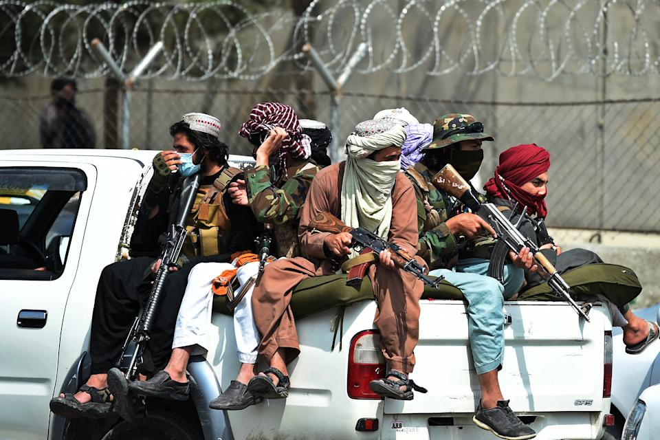 TOPSHOT - Taliban fighters guard outside the airport in Kabul on August 31, 2021, after the US has pulled all its troops out of the country to end a brutal 20-year war -- one that started and ended with the hardline Islamist in power. (Photo by Wakil KOHSAR / AFP) (Photo by WAKIL KOHSAR/AFP via Getty Images)