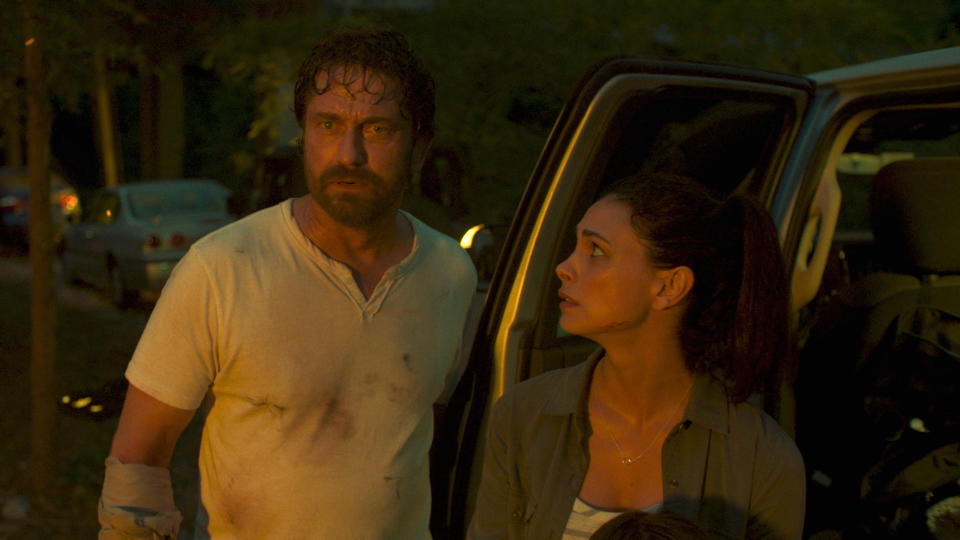 Gerard Butler and Morena Baccarin flee the apocalypse in 'Greenland'. (Credit: STX/Amazon)