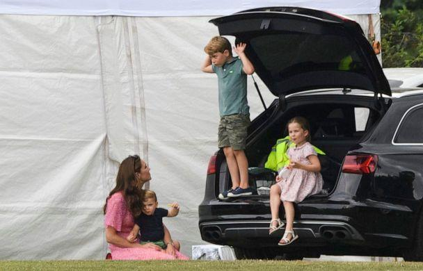 PHOTO: Catherine Duchess of Cambridge sits with the royal children, Prince Louis, Princess Charlotte and Prince George at the King Power Royal Charity Polo Day in Wokingham, UK on July 10, 2019. (Tim Rooke/REX/Shutterstock)