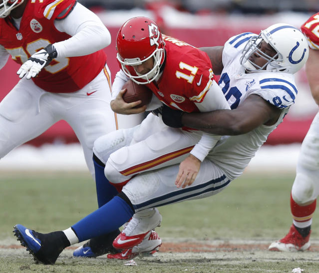 Kansas City Chiefs quarterback Alex Smith (11) is sacked by Indianapolis Colts defensive end Cory Redding (90) during the second half of an NFL football game at Arrowhead Stadium in Kansas City, Mo., Sunday, Dec. 22, 2013. (AP Photo/Ed Zurga)