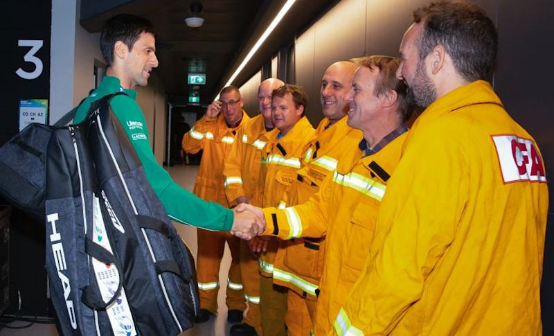 Serbia's Novak Djokovic meets with Country Firefighters ahead of the men's singles final against Austria's Dominic Thiem at the Australian Open tennis championship in Melbourne, Australia, Sunday, Feb. 2, 2020. (Fiona Hamilton/Tennis Australia via AP))