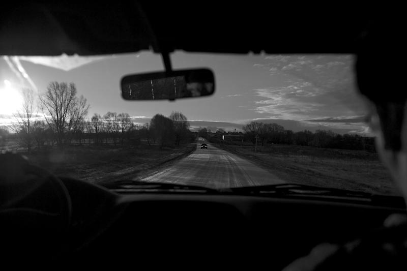In this Nov. 14, 2012, photo, a road leads into the village of Yarabaikasy, near Cheboksary, the capital city of Chuvashia, Russia. Eduard Mochalov has found a new lease on life as a crusading journalist investigating corruption in his native region, fueled by tips from disgruntled businessmen and government workers. Undeterred by a system where the law is selectively used to protect the powerful and crack down on critics, Mochalov has quickly earned cult status _ not to mention the ire of countless local officials _ throughout the small province of Chuvashia. (AP Photo/Alexander Zemlianichenko)