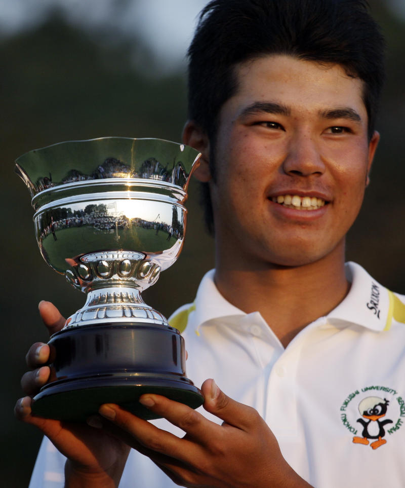 Hideki Matsuyama of Japan holds his trophy after winning the low amateur at the Masters golf tournament Sunday, April 10, 2011, in Augusta, Ga. (AP Photo/Charlie Riedel)