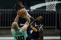 Denver Nuggets forward Paul Millsap blocks a shot by Charlotte Hornets center Cody Zeller during the first half of an NBA basketball game on Tuesday, May 11, 2021, in Charlotte, N.C. (AP Photo/Chris Carlson)