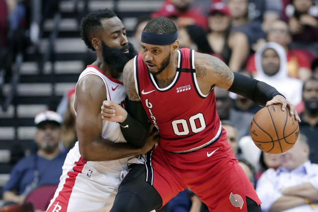 Portland Trail Blazers forward Carmelo Anthony (00) drives up against Houston Rockets guard James Harden during the second half of an NBA basketball game Wednesday, Jan. 15, 2020, in Houston. (AP Photo/Michael Wyke)
