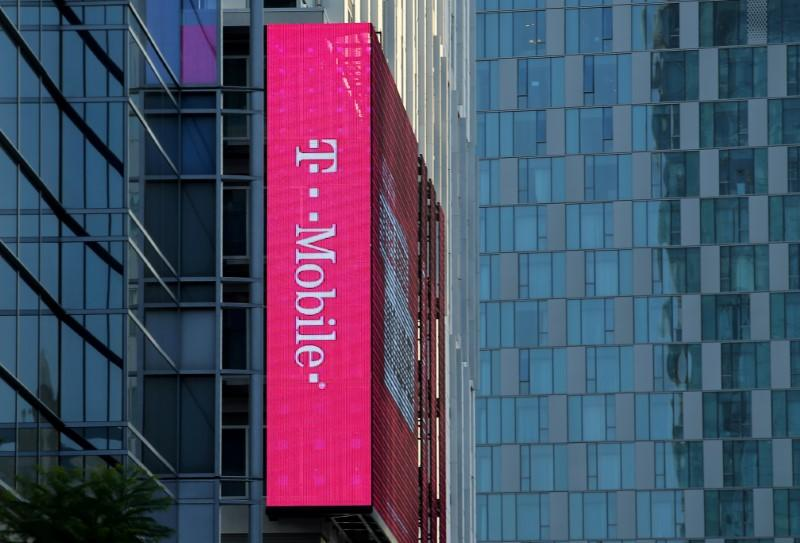 FILE PHOTO: T-Mobile logo is advertised on building sign in Los Angeles