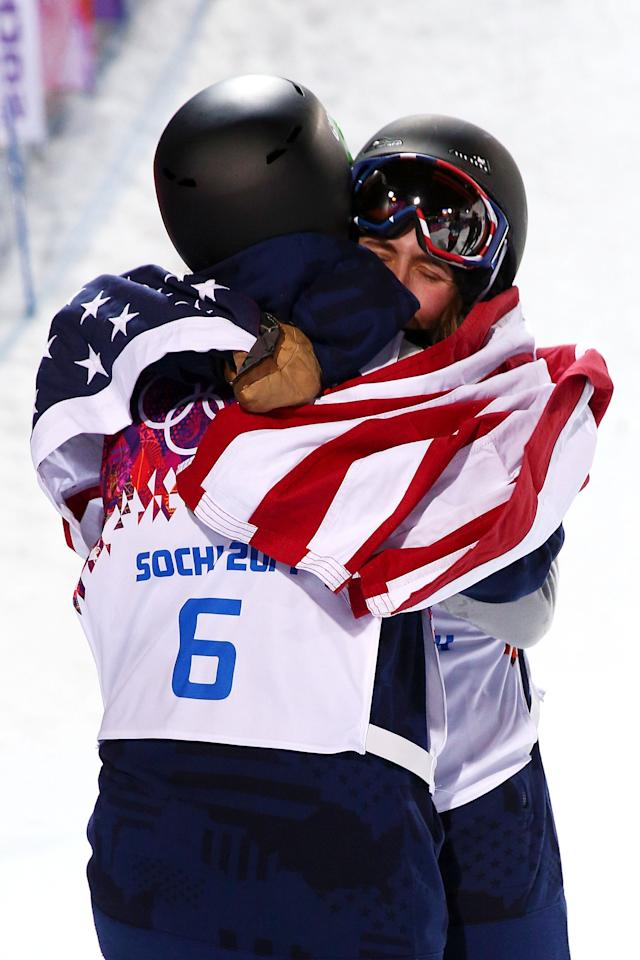 SOCHI, RUSSIA - FEBRUARY 20: Maddie Bowman (R) of the United States celebrates winning the gold medal with Brita Sigourney of the United States in the Freestyle Skiing Ladies' Ski Halfpipe Finals on day thirteen of the 2014 Winter Olympics at Rosa Khutor Extreme Park on February 20, 2014 in Sochi, Russia. (Photo by Cameron Spencer/Getty Images)
