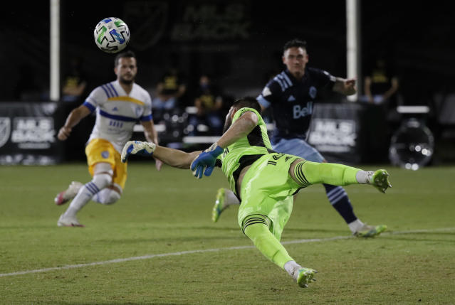 Vancouver Whitecaps goalkeeper Maxime Crepeau blocks a shot during the first half of the team's MLS soccer match against the San Jose Earthquakes, Wednesday, July 15, 2020, in Kissimmee, Fla. (AP Photo/John Raoux)