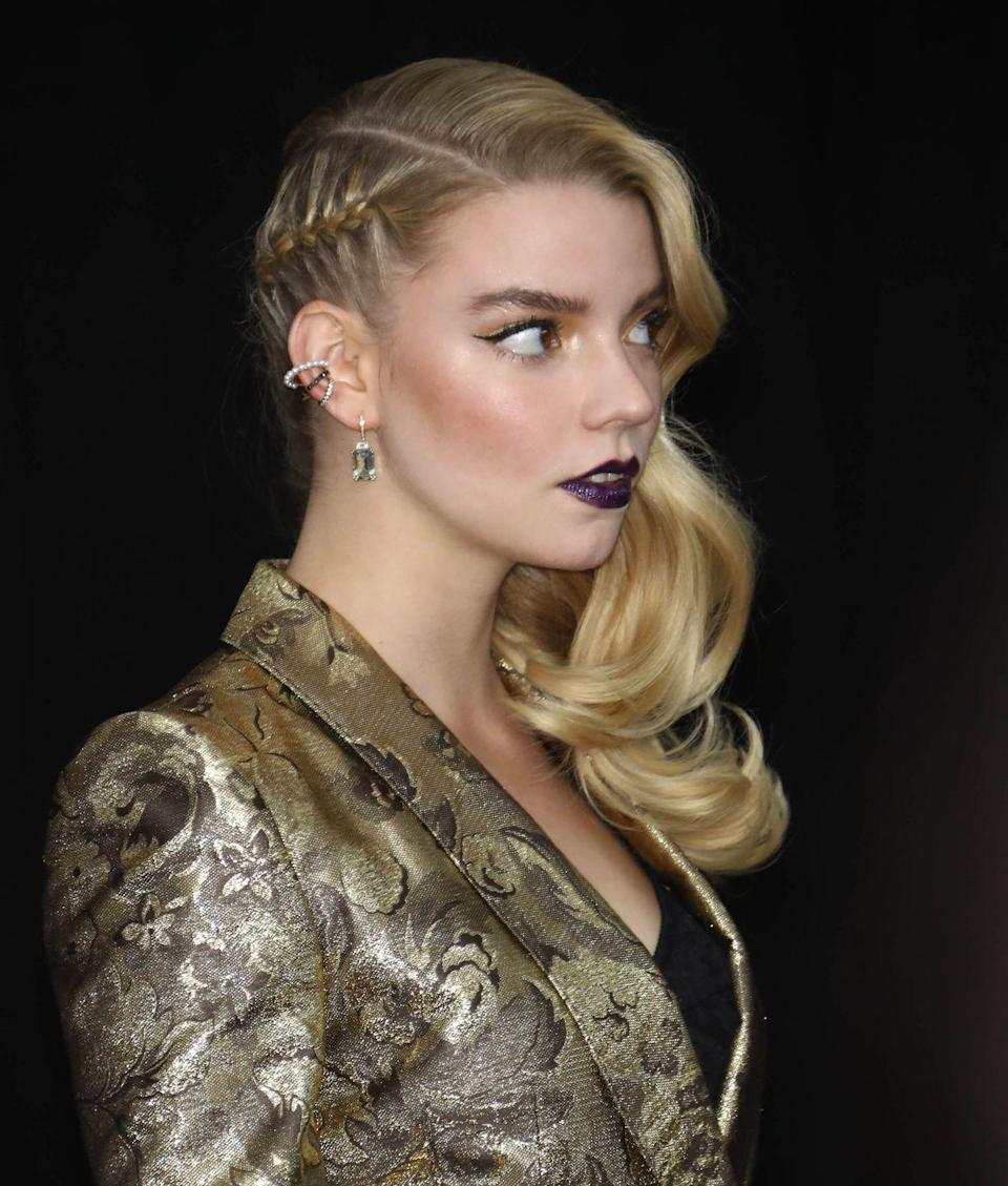 <p>Jazz up a side-swept curly hairstyle by weaving a single braid on the side. </p>