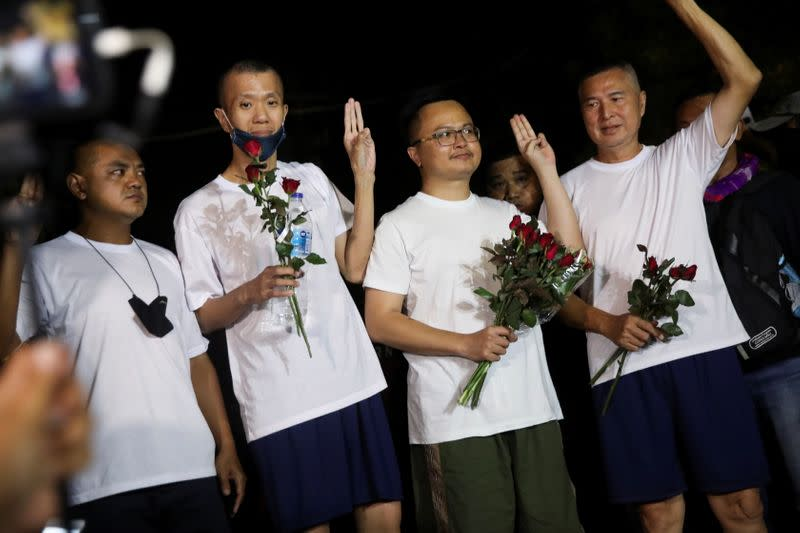 Human rights lawyer Anon Nampa, one of the leaders of recent anti-government protests, shows the three-finger salute as he released from Prison in Bangkok