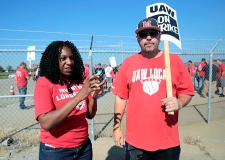 Striking GM assembly workers talk about their transplanted jobs with GM during a rally outside the shuttered Lordstown Assembly plant in Lordstown, Ohio