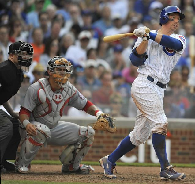 Chicago Cubs' John Baker watches his three-run double during the seventh inning of a baseball game against the Washington Nationals in Chicago, Friday, June 27, 2014. (AP Photo/Paul Beaty)