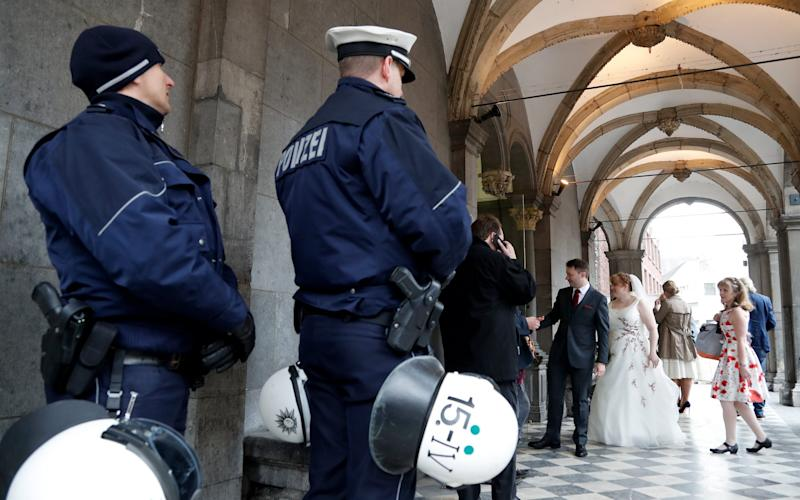 German police guard a wedding at the historical town hall next to the AfD party conference  - Credit: EPA