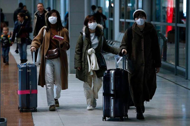 Travelers at a Paris airport on Monday   OAN VALAT/EPA-EFE/Shutterstock