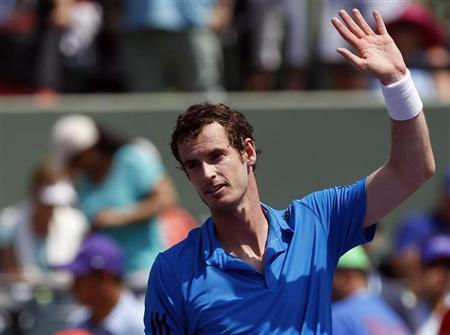 Mar 23, 2014; Miami, FL, USA; Andy Murray waves to the crowd after his match against Feliciano Lopez (not pictured) on day seven of the Sony Open at Crandon Tennis Center. Murray won 6-4, 6-1. Mandatory Credit: Geoff Burke-USA TODAY Sports - RTR3I941