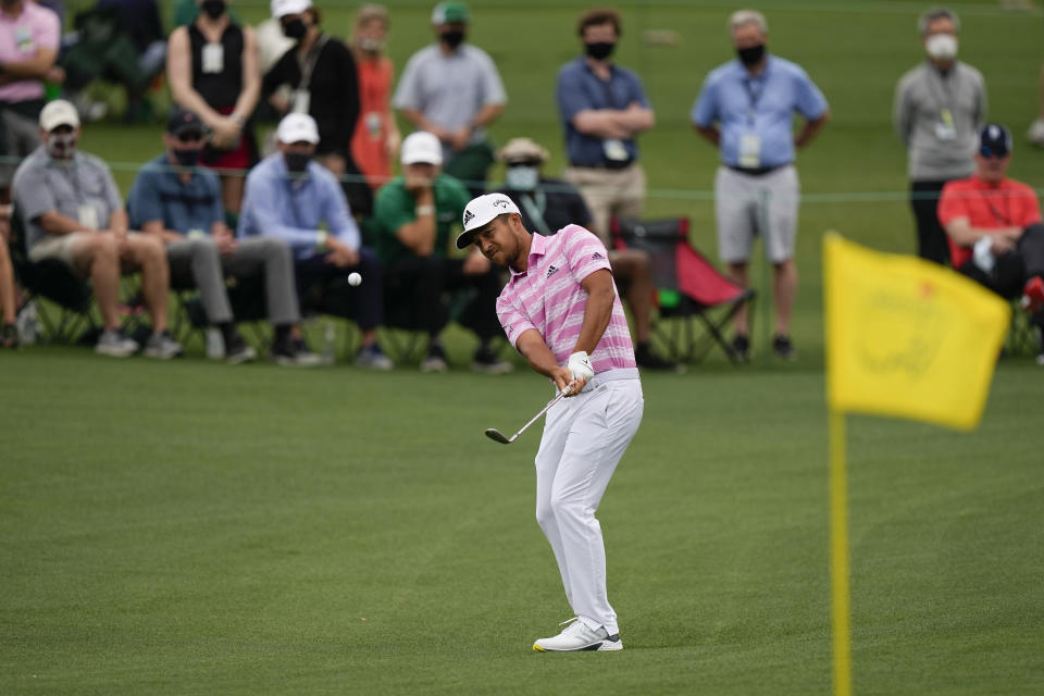 Xander Schauffele hits to the second green during the third round of the Masters golf tournament on Saturday, April 10, 2021, in Augusta, Ga. (AP Photo/David J. Phillip)