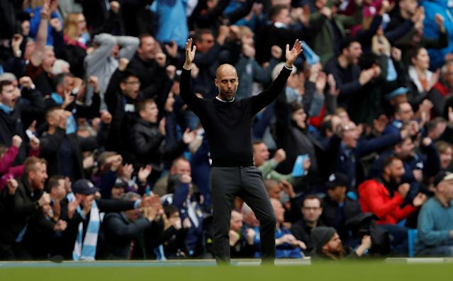"Soccer Football - Premier League - Manchester City v Swansea City - Etihad Stadium, Manchester, Britain - April 22, 2018 Manchester City manager Pep Guardiola celebrates their third goal scored by Kevin De Bruyne Action Images via Reuters/Lee Smith EDITORIAL USE ONLY. No use with unauthorized audio, video, data, fixture lists, club/league logos or ""live"" services. Online in-match use limited to 75 images, no video emulation. No use in betting, games or single club/league/player publications. Please contact your account representative for further details. TPX IMAGES OF THE DAY"