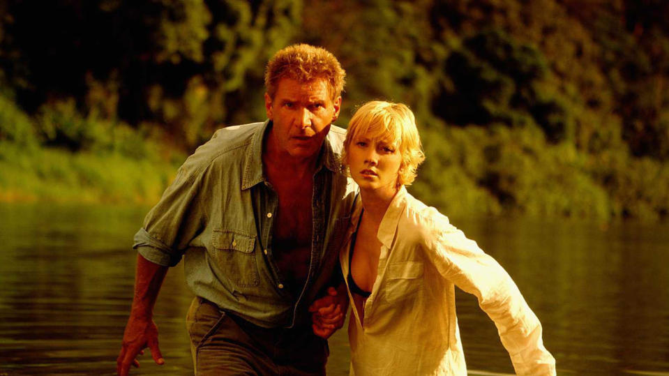 Harrison Ford and Anne Heche in 1998 movie 'Six Days, Seven Nights'. (Credit: Buena Vista Pictures/Getty Images)