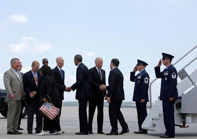 <p>Obama greets Republican Florida Gov. Rick Scott. Biden greets Republican Florida Sen. Marco Rubio as the president and vice president arrive in Orlando, Fla., to meet with families of the victims of the Pulse nightclub shooting, June 16, 2016. (Carlos Barria/Reuters) </p>