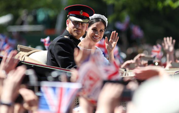 Image: Britain's Prince Harry, Duke of Sussex and his wife Meghan, Duchess of Sussex wave from the Ascot Landau Carriage during their carriage procession on the Long Walk as they head back towards Windsor Castle (Daniel Leal-Olivas / AFP via Getty Images)