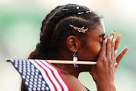 """<p>Wearing """"wild"""" and bedazzled barrettes tucked into a braided hairstyle with Cool Ranch Doritos earrings at the 2021 Olympic Trials.</p>"""