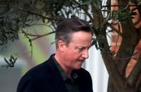 FILE PHOTO: Former British Prime Minister David Cameron leaves his home in London