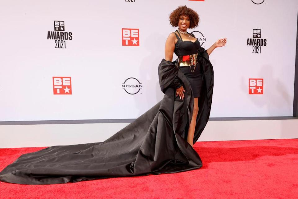 Jennifer Hudson attends the BET Awards 2021 in a dress with a large metal belt and matching duster
