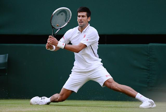 LONDON, ENGLAND - JULY 01: Novak Djokovic of Serbia in action during the Gentlemen's Singles fourth round match against Tommy Haas of Germany on day seven of the Wimbledon Lawn Tennis Championships at the All England Lawn Tennis and Croquet Club on July 1, 2013 in London, England. (Photo by Mike Hewitt/Getty Images)