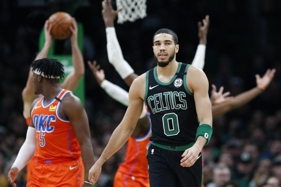 Boston Celtics' Jayson Tatum (0) on the court during the second half of an NBA basketball game against the Oklahoma City Thunder, Sunday, March, 8, 2020, in Boston. (AP Photo/Michael Dwyer)
