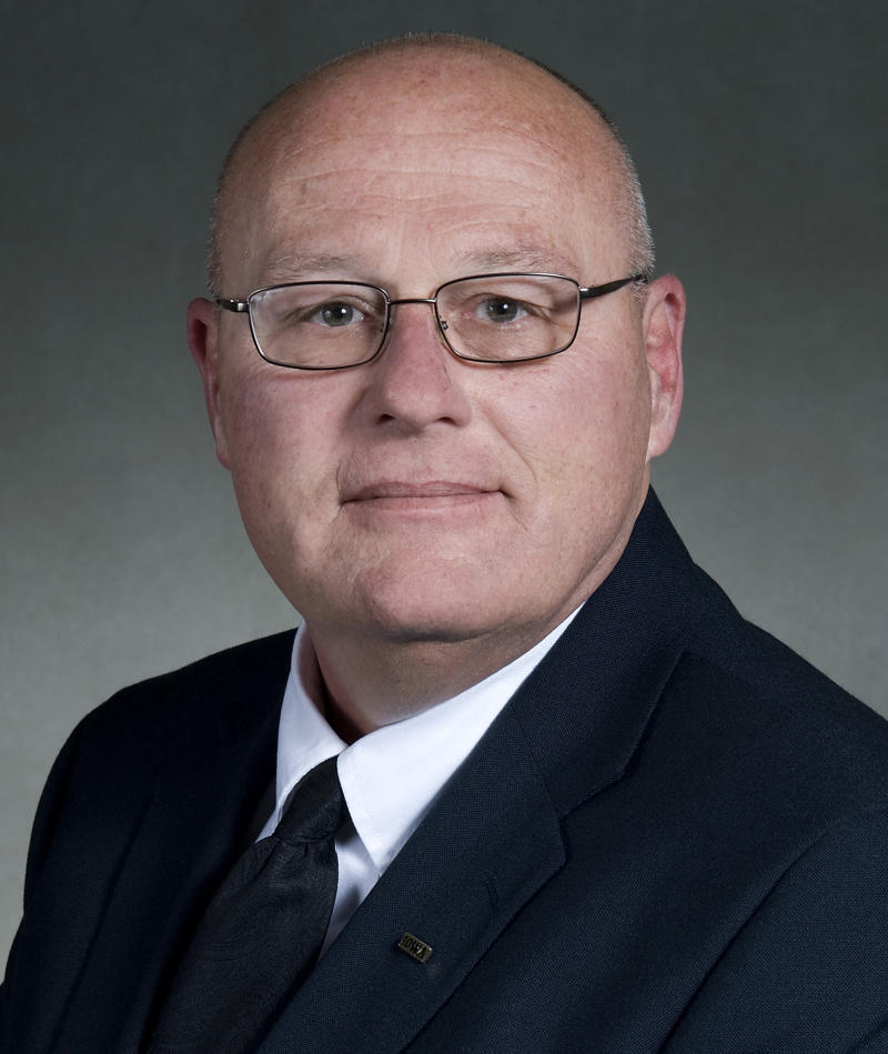 This undated photo provided by The University of Iowa shows former Iowa athletics department counselor Peter Gray.  A university oversight official on Tuesday, Nov. 13, 2012, defended the school's decision to hire Gray to oversee its advising and counseling program for athletes in 2002 after he had left the university in 1995. Gray resigned last week after an internal report obtained by the Iowa City Press-Citizen concluded that he had violated the university's sexual harassment policy by improperly touching students and athletes throughout his tenure, dating back to his first earlier employment from 1993 to 1995. (AP Photo/Courtesy University of Iowa)