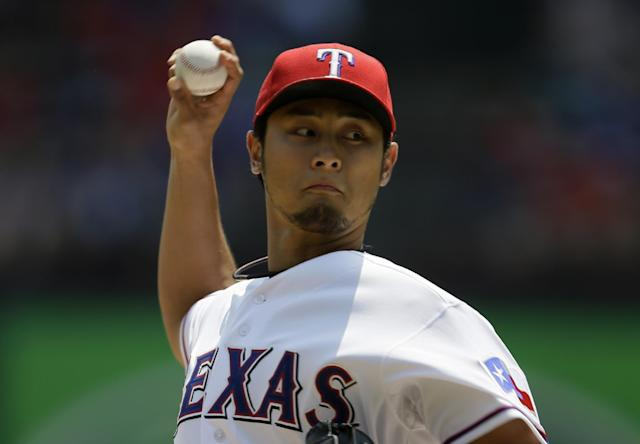 Texas Rangers starting pitcher Yu Darvish, of Japan, works against the Seattle Mariners in the first inning of a baseball game on Sunday, Aug. 18, 2013, in Arlington, Texas. (AP Photo/Tony Gutierrez)