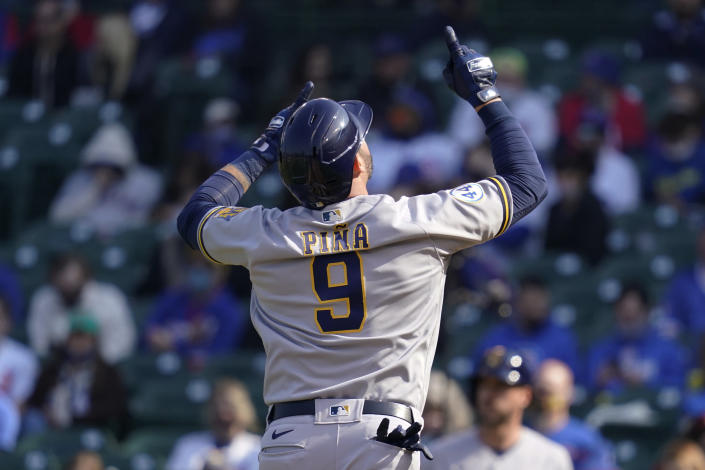 Milwaukee Brewers' Manny Pina celebrates as he rounds the bases after hitting a two-run home run during the seventh inning of a baseball game against the Chicago Cubs in Chicago, Saturday, April 24, 2021. (AP Photo/Nam Y. Huh)