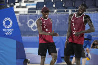 Cherif, Younousse, right, of Qatar, and teammate Ahmed Tijan, celebrate after winning a men's beach volleyball match against Italy at the 2020 Summer Olympics, Wednesday, July 28, 2021, in Tokyo, Japan. (AP Photo/Petros Giannakouris)