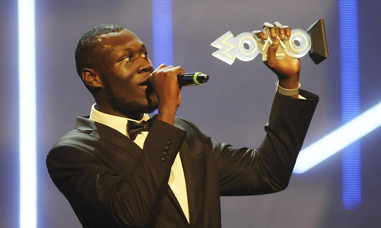 Stormzy accepts the Mobo award for best grime act in 2015.