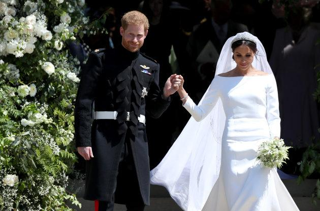 Prince Harry and Meghan Markle leave St George's Chapel in Windsor Castle after their wedding. Her wedding dress, designed by Clare Waight Keller for Givenchy, has a bateau neckline.