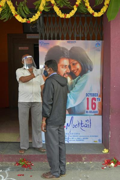 Temperature checks and masks are the new normal at India's re-opened cinemas