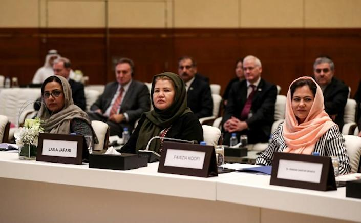Afghan women take part in a breakthrough meeting with the Taliban in Doha (AFP Photo/KARIM JAAFAR)