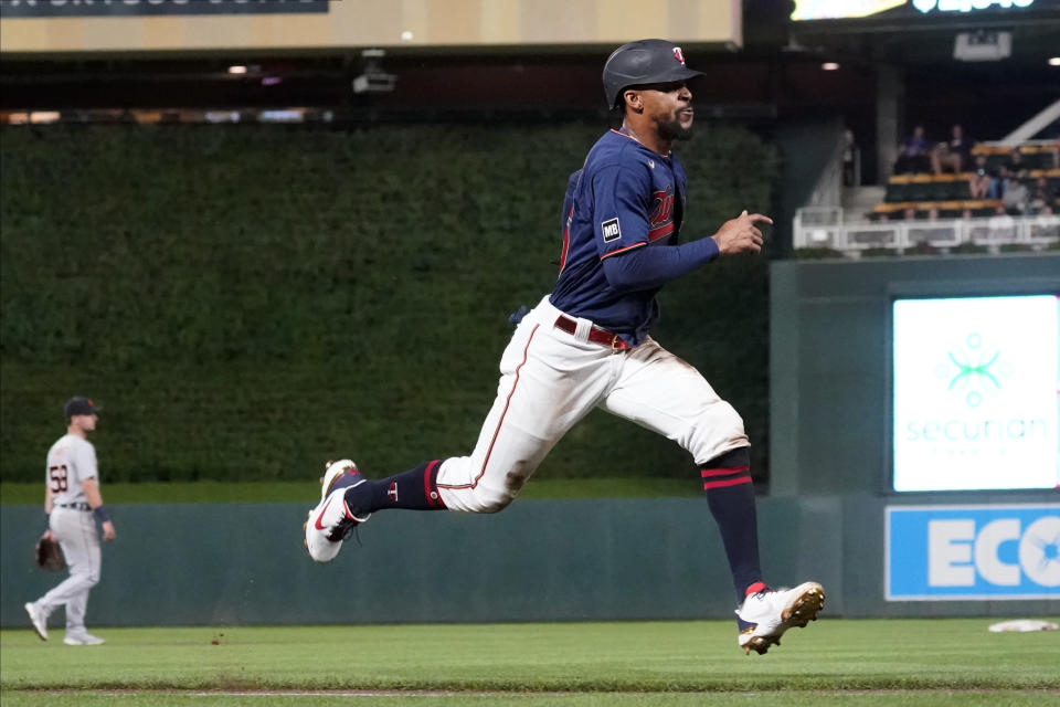 CORRECTS TO THIRD INNING - Minnesota Twins' Byron Buxton races home to score on a sacrifice fly by Mitch Garver in the third inning of a baseball game against the Detroit Tigers, Tuesday, Sept. 28, 2021, in Minneapolis. (AP Photo/Jim Mone)