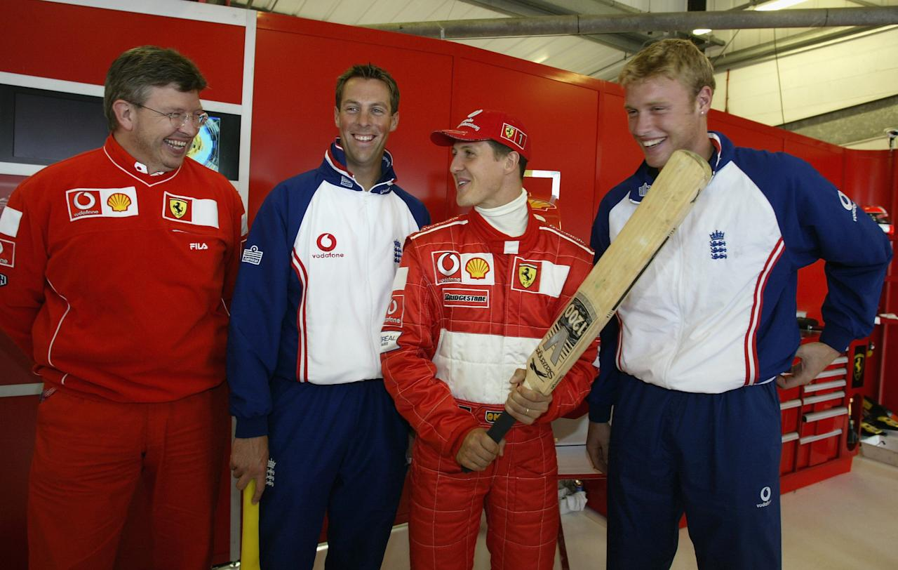 SILVERSTONE - JULY 5:  (l to r) Ross Brawn, Marcus Trescothick, Michael Schumacher and Andrew Flintoff after first practice for the British Grand Prix at Silverstone on July 5, 2002 at Silverstone Circuit, Northamptonshire,  England. (Photo by: Clive Mason/Getty Images.)