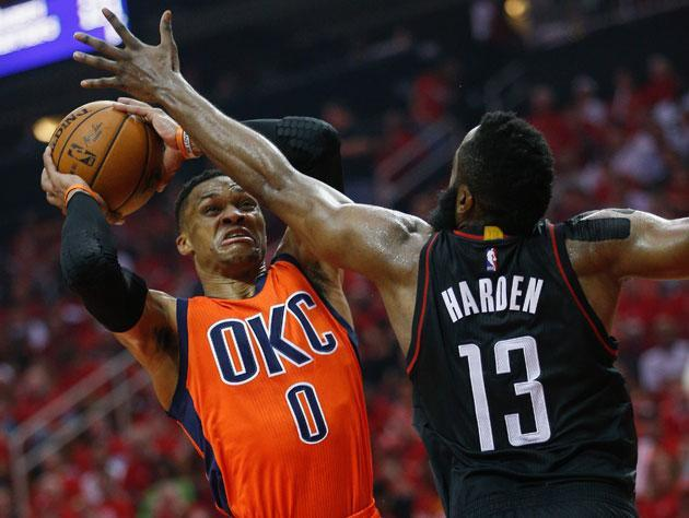 "<a class=""link rapid-noclick-resp"" href=""/nba/players/4390/"" data-ylk=""slk:Russell Westbrook"">Russell Westbrook</a> looks out for his mate. (Getty Images)"